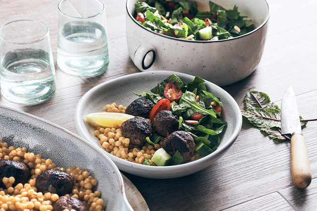 Teaser image for One-pan venison meatballs with Israeli couscous and salad