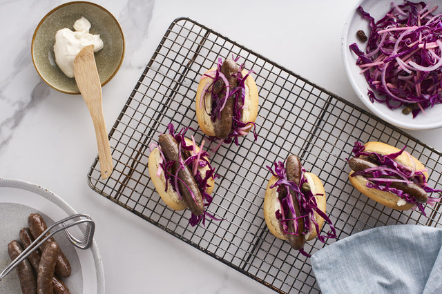 Teaser image for First Light venison chipolatas with red cabbage slaw